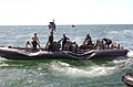 US Navy 042904-N-7034S-003 Sailors assigned to Naval Amphibious Base Little Creek's Special Boat Unit Two Zero (SBU-20) set-up a Rigid Hull Inflatable Boat (RHIB).jpg