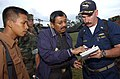 US Navy 050404-N-6665R-212 Cmdr. Kurt Hummeldorf, right, exchanges contact information with the governor of North Sumatra, Indonesia, upon arrival to Nias, Indonesia.jpg