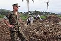 US Navy 060219-M-4855P-012 U.S. Marine Corps Brig. Gen. Mastin M. Robeson surveys the area covered by the mudslide at Guinsangon.jpg