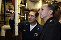 US Navy 060510-N-3136P-042 Commander, U.S. 7th Fleet, Vice Adm. Jonathan Greenert, is briefed by Chief Engineer, Capt. Pete Schupp in the main machinery room aboard the conventionally-powered aircraft carrier USS Kitty Hawk (CV.jpg