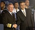 US Navy 061025-N-5330L-235 The President of Montenegro, Filip Vujanovic, and Commander, U.S. Naval Forces Europe Adm. Harry Ulrich III, shake hands during a reception aboard the guided missile cruiser USS Anzio (CG 68).jpg