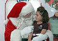 US Navy 061202-N-1595A-004 A child sits on Santa's lap while getting her picture taken during the annual Children's Holiday Party at Naval Base San Diego.jpg