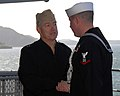 US Navy 070228-N-3659B-026 Rear Adm. James D. Kelly, Commander U.S. Naval Forces Japan, (CNFP) shakes hands with the boatswain's mate that piped him aboard USS Ronald Reagan (CVN 76).jpg