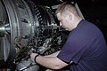 US Navy 070825-N-1730J-069 Aviation Machinist's Mate 3rd Class John Mcnulty installs a fan variable guide on an F-414 jet engine aboard nuclear-powered aircraft carrier USS Nimitz (CVN 68).jpg
