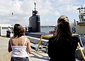 US Navy 071016-N-6357K-021 Family members look on as Los Angeles-class fast attack submarine USS Topeka (SSN 754) prepares to gets underway for a scheduled deployment.jpg