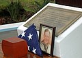 US Navy 071207-N-7310D-013 An American flag and a picture of Richard Adams are on display during an internment ceremony for Adams at the USS Utah Memorial.jpg