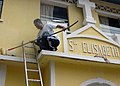 US Navy 071219-N-4014G-090 Storekeeper 2nd Class Tomas Lomotan helps to paint the exterior of the St. Elizabeth Convent and Orphanage during a community Relations Project.jpg