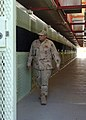 US Navy 080214-N-5416W-006 A member of the Navy Expeditionary Guard Battalion patrols a corridor in the Camp Delta section of the Joint Detention Group facility in Guantanamo Bay, Cuba.jpg