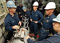 US Navy 080217-N-5476H-015 Gunner's Mate 1st Class Kacy Rupp, from Billings, Okla., explains different aspects of the plug puller mechanism of the MK32-MOD14 service vessel torpedo tube.jpg