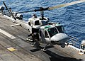 US Navy 080902-N-2183K-125 A UH-1N Twin Huey helicopter carefully lands aboard the amphibious assault ship USS Peleliu (LHA 5).jpg
