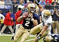 US Navy 081115-N-4565G-053 Navy quarterback Jarod Bryant (^2), from Hoover, Alabama, eludes Notre Dame defensive end Pat Kuntz (^96) during a first quarter pass attempt in the Saturday, Nov. 15, 2008 college football game.jpg