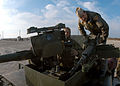 US Navy 090215-N-2636M-051 Lance Cpl. Carman Williams shows Rear Adm. Gary White a humvee's weapons system.jpg