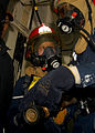 US Navy 090309-N-6523K-017 Electrician's Mate 3rd Class Harvey Anderson, in-port emergency team hose team leader, instructs his hose team before entering a space during a damage control drill.jpg