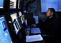 US Navy 090615-N-9928E-024 Operations Specialist 1st Class Lee Tran, from Portland, Oregon, monitors links in the tactical flag command center aboard the aircraft carrier USS John C. Stennis (CVN 74).jpg