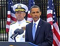 US Navy 090911-N-8273J-048 President Barack Obama delivers remarks during a Sept. 11 remembrance ceremony at the Pentagon Memorial as Adm. Mike Mullen, chairman of the Joint Chiefs of Staff looks on.jpg