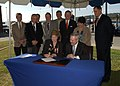 US Navy 090924-N-5188B-048 Honorable Ray Mabus and members of the Connecticut State legislature watch Connecticut Governor Jodi Rell sign a new grant letter allotting $7.65 million from the state for improvements.jpg