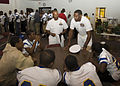 US Navy 091002-N-9791D-001 Two Navy special warfare operators (SEAL) assigned to an East Coast based SEAL team talk with football players at Dudley High School in Greensboro, N.C.jpg