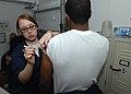 US Navy 100126-N-2798F-115 USS Harry S. Truman Sailor gets immunizations.jpg