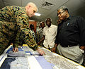 US Navy 100206-N-5345W-151 Haitian Prime Minister Jean-Max Bellerive listens as Col. Gareth Brandl explains relief operations.jpg
