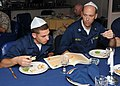 US Navy 100405-N-1082Z-095 Lt. David J. Jeltema and Boatswain's Mate Seaman Michael A. Stone read from the Haggadah, the religious text that sets out the order of the Passover Seder.jpg