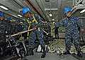 US Navy 100511-N-4516G-107 Seaman Christopher F. Peggins releases a riding stopper from a starboard-side anchor chain.jpg