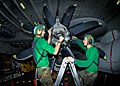 US Navy 100810-N-6720T-004 Sailors install a variable pitch propeller on an E-2C Hawkeye from the Liberty Bells of Airborne Early Warning Squadron (VAW) 115 aboard the aircraft carrier USS George Washington (CVN 73).jpg