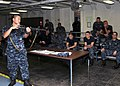 US Navy 100825-N-6165A-013 Gunner's Mate 2nd Class Weijen Tseng teaches Sailors assigned to the submarine tender USS Frank Cable (AS 40) how to properly use an M16 service rifle.jpg