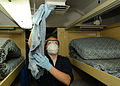 US Navy 100922-N-1092P-025 Seaman Amanda Carlton cleans the air-conditioning vents in a berthing compartment aboard the Nimitz-class aircraft carri.jpg