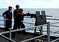 US Navy 100925-N-6632S-127 Sailors assigned to the weapons department of the aircraft carrier USS George H.W. Bush (CVN 77) fire a .50-caliber mach.jpg