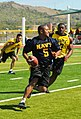 US Navy 101211-M-5775W-632 ngineman 2nd Class Johnny Abner runs with the ball during an Army-Navy flag football game at Cooper Field.jpg