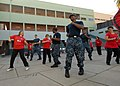 US Navy 110625-N-ZI300-152 Sailors a take part in latin-style dancing with a women's dance group during a community service event.jpg
