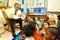 US Navy 110908-N-GO179-001 Harold Jones, a paralegal specialist and diversity officer at Navy Medicine Support Command, reads to first-grade studen.jpg