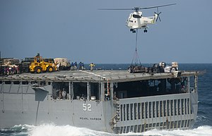 US Navy 111210-N-PB383-909 A helicopter from the Military Sealift Command dry cargo and ammunition ship USNS Alan Shepard (T-AKE 3) delivers suppli.jpg