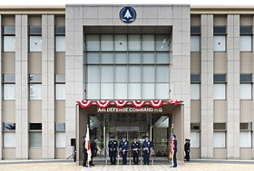 US and Japanese leaders cut the ribbon during the opening ceremony for the new Japan Air Self-Defense Force Air Defense Command Headquarters.jpg