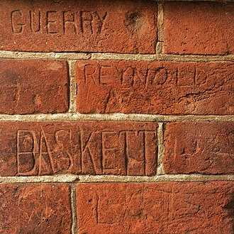 The Range -  Student names scratched into bricks.