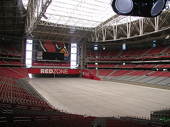 The interior of State Farm Stadium with field removed. To protect the stadium's grass playing surface, non-sporting events are always held with the facility in this configuration. University of Phoenix Stadium no field.jpg