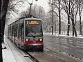 VIenna Ringstrasse Trams in Snow (8499667291).jpg