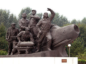 Korean People's Army - A monument in Pyongyang, depicting North Korean airmen and a MiG fighter.