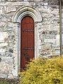 Voss Church (Voss kirke-kyrkje, Vangskyrkja) 13th-c stone church, Voss, Norway 2016-10-25 -06- side door stone wall.jpg