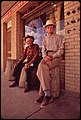 """W.G. Leistikon, 70; and John Ricks, 87, in Front of the Local Drugstore. Stumps in Front of Store Are Reserved for the """"Old-Timers"""" 11-1972 (3703564727).jpg"""