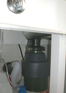a garbage disposal unit installed under a kitchen sink - Kitchen Sink Grinder
