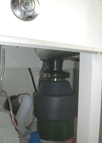 Garbage disposal unit - A garbage disposal unit installed under a kitchen sink