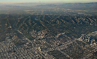 Westwood, Los Angeles - Late afternoon aerial photograph of Westwood (center), with Century City at the far right and the Santa Monica Mountains and  San Fernando Valley in the background