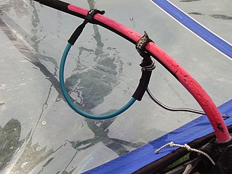 Boom (windsurfing) - Detail of boom with harness lines (one side visible).