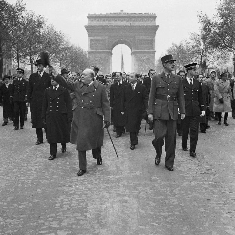 Winston Churchill and General Charles de Gaulle walk down the Avenue des Champs-Elysee duirng the French Armistice Day parade in Paris, 11 November 1944. BU1292