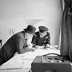 Winston Churchill studies after action reports with Vice Admiral Sir Bertram Ramsay, Flag Officer Comanding Dover, 28 August 1940. H3508.jpg