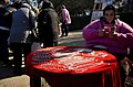 Woman-selling-market-bucharest-october-2014.jpg