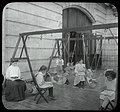 Women and girls reading near swingset where younger children - (3109300565).jpg