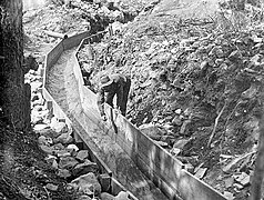 Wooden gold sluice in California between 1890 and 1915..jpg