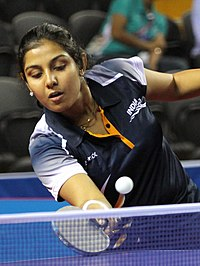 XIX Commonwealth Games-2010 Delhi (Women's Table Tennis) Poulomi Ghatak of India in an action against Zhenhua Vivian Tan of Australia, at Yamuna Sports Complex, in New Delhi on October 06 2010 (cropped).jpg